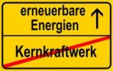 Thumbnail City limits sign with the words erneuerbare Energien and Kernkraftwerk, German for renewable energy and nuclear power station, symbolic image for the end of nuclear power through the use of renewa