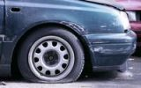 Thumbnail Flat tyre on a car involved in an accident