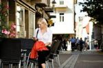 Thumbnail Young woman in a sidewalk cafe