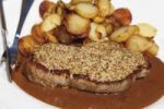Thumbnail Roast pork with mustard crust and baked potatoes