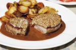 Thumbnail Young roast pork with mustard crust and baked potatoes