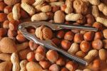 Thumbnail Mixed nuts with a nutcracker