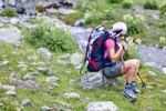 Thumbnail Hiker taking a break from hiking down Mt Cima Vertana, Ortles area, South Tyrol, Austria, Europe