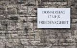"Thumbnail ""Donnerstag 17 Uhr Friedensgebet"" German for ""Thursday, 5pm, prayer for peace"", sign on a church wall, Erfurt, Thuringia, Germany, Europe"