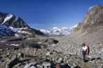 Thumbnail Hiker during ascent of Mt Tschenglser Hochwand above Duesseldorfer Huette hut in Sulden, Mt Vertainspitze, Mt Koenigsspitze and Mt Zebru at back, Suldental valley, South Tyrol, Italy, Europe