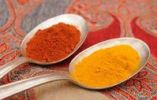 Thumbnail Spices on old spoons, paprika and curry powder