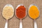 Thumbnail Spices on an old spoon, ginger, paprika and curry powder