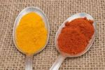 Thumbnail Spices on old spoons, curry and paprika powder