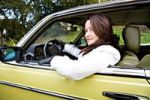 Thumbnail Young woman in a post-war classic car