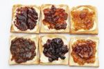 Thumbnail Six slices of toast with various jams, rhubarb jam, apricot jam, strawberry jam, orange marmalade, cherry jam and ginger marmalade