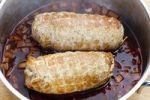 Thumbnail Pork roulade in a net in a casserole pot