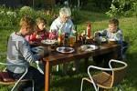 Thumbnail family eating in the garden