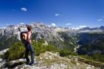 Thumbnail Hiker on Monte Piano overlooking the Alta Pusteria valley, with the Rienz Valley at the rear, Dolomites, Alto Adige, Italy, Europe