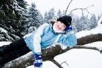 Thumbnail Girl on a tree trunk in the snow
