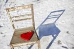 Thumbnail Red wooden heart on an old chair in the snow