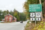 Thumbnail Road sign on Highway 2 and 17 with surprising placenames, Mexico, Rumford, Peru, Maine, New England, USA, North America