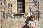 Thumbnail a man with a cowboy hat rests San Salvatore Sardegna Italy