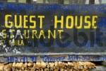 Thumbnail Sign Guest House with graffity of the rebels Maos Maoists Annapurna Region Nepal