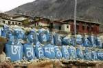 Thumbnail Tibetan script on blue painted rocks in a row in front of old monastery Tashi Gompa Phu Nar-Phu Annapurna Region Nepal
