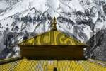 Thumbnail Yellow roof of monastery Thare Gompa with snow-covered slope in the background near Khangsar Annapurna Region Nepal