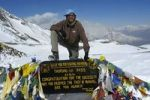Thumbnail successful mountaineer at the sign with prayer flags in the snow Thorung La Pass 5416 m Annapurna Region Nepal