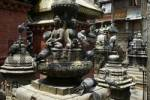 Thumbnail Many shrines chaityas and statues with pigeons in Seto Macchendranath Temple Kel Tole Kathmandu Nepal