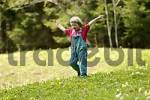 Thumbnail One three-year-old girl running down a meadow in spring