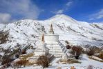 Thumbnail Tibetan Buddhism two white stupas on snow covered mountain Drak Yerpa Tibet China