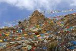 Thumbnail Tibetan Buddhism many colourful prayer flags at steep mountain Drak Yerpa Tibet China