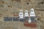 Thumbnail Tibetan Buddhism white stupas with grey and dark red painted walls Sakya Monastery Tibet China