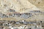 Thumbnail Traditional houses of the old town with grey and dark red painted walls at the mountain slope Sakya Monastery Tibet China