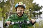 Thumbnail Boy on bicycle with bicycle helmet
