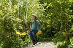 Thumbnail One seven-year-old boy on a swing