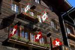 Thumbnail Front face of a chalet decorated with flags Wiler Valais Switzerland