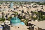 Thumbnail View onto the roofs of the old town with the blue cupola of Pahlavon-Maxmud-Mausoleum and the unfinished minaret Kaltar Minor from the minaret of Islom-Xoja Madrasah Khiva Uzbekistan