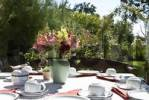 Thumbnail Well-laid garden table with a bunch of snapdragons Antirrhinum