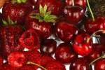 Thumbnail assorted red fruit on white background