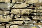 Thumbnail Wall of the historic early christian Saint Columcille abbey, constructed from piled up stones, Co Donegal Ireland