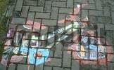 Thumbnail child paints with road-chalks