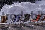 Thumbnail Deck-chairs in front of big heap of snow near Oberstdorf, Allgäu, Bavaria Germany