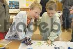 Thumbnail pupils of a 4th class in primary school painting on cloth