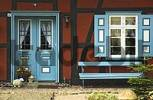 Thumbnail Colored entrance door and windows at a typical house at Wustrow Fischland Germany