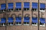 Thumbnail Blue sun shades at the front of an office building in Hamburg, Germany