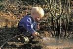 Thumbnail Child watering a bush