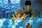 Thumbnail Child and mother in a indoor pool