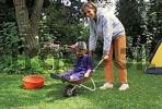 Thumbnail Mother with two-year-old boy in wheelbarrow MR