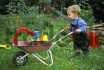 Thumbnail One-year-old with wheelbarrow and leather trousers MR