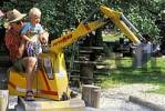 Thumbnail Two-year-old boy on toy digger MR
