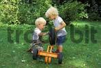Thumbnail Two three year old boys repairng tricycle MR