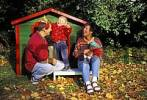 Thumbnail Mother - father and two-year-old boy in front of a toy house in autumn MR